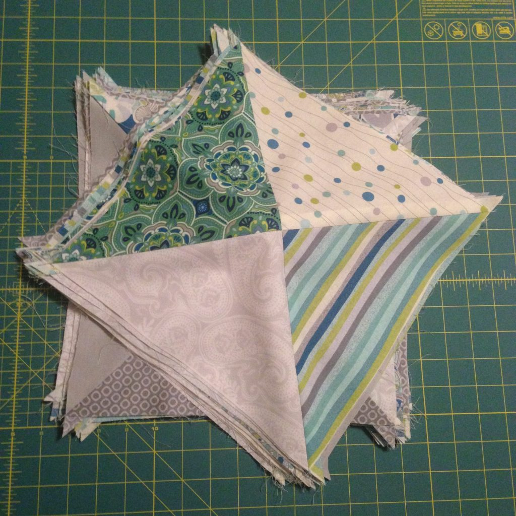Lots of half square triangles. The final blocks to be arranged in the quilt! - making progress here at Stacey Sansom Designs